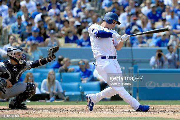 Joc Pederson of the Los Angeles Dodgers connects for a grand slam as Austin Hedges of the San Diego Padres looks on during the third inning of an...