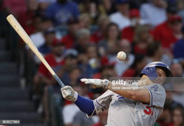 Joc Pederson of the Los Angeles Dodgers fouls off a pitch in the third inning during the MLB game against the Los Angeles Angels of Anaheim at Angel...