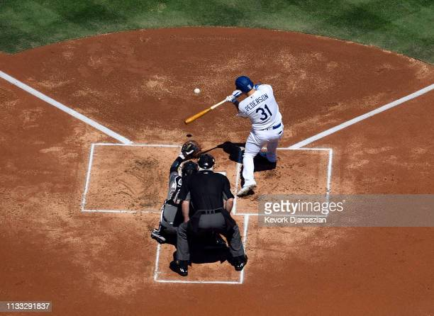 Joc Pederson of the Los Angeles Dodgers hits a double against pitcher Zack Greinke of the Arizona Diamondbacks during the first inning on Opening Day...