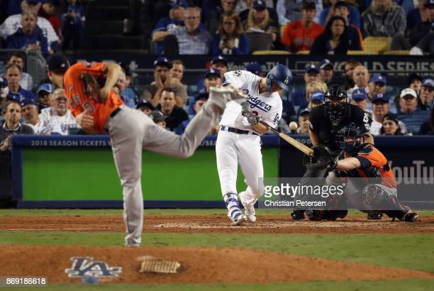Joc Pederson of the Los Angeles Dodgers hits a single agaisnt Charlie Morton of the Houston Astros during the sixth inning in game seven of the 2017...