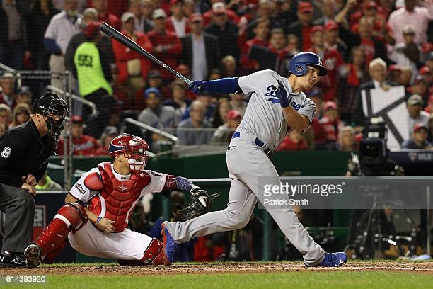 Joc Pederson of the Los Angeles Dodgers hits a single in the fifth inning against the Washington Nationals during game five of the National League...