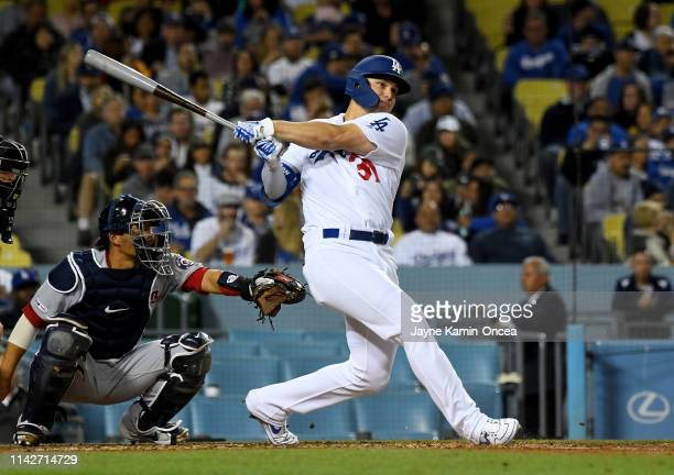 Joc Pederson of the Los Angeles Dodgers hits a solo home run for his second of the game in the fifth inning against the Washington Nationals at...