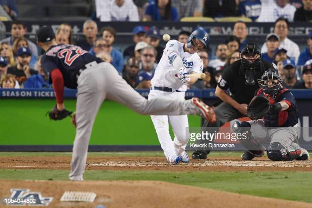 Joc Pederson of the Los Angeles Dodgers hits a third inning home run on a pitch from Rick Porcello of the Boston Red Sox in Game Three of the 2018...