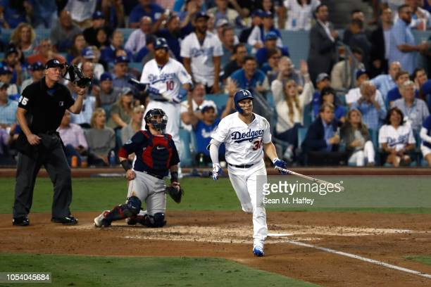 Joc Pederson of the Los Angeles Dodgers hits a third inning home run against the Boston Red Sox in Game Three of the 2018 World Series at Dodger...