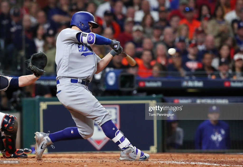 Joc Pederson #31 of the Los Angeles Dodgers hits a three-run home run during the ninth inning against the Houston Astros in game four of the 2017 World Series at Minute Maid Park on October 28, 2017 in Houston, Texas.