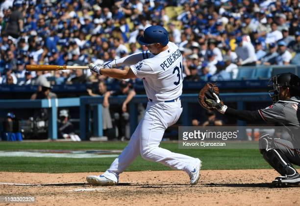 Joc Pederson of the Los Angeles Dodgers hits a tworun home run against Arizona Diamondbacks during the sixth inning at Dodger Stadium on March 28...