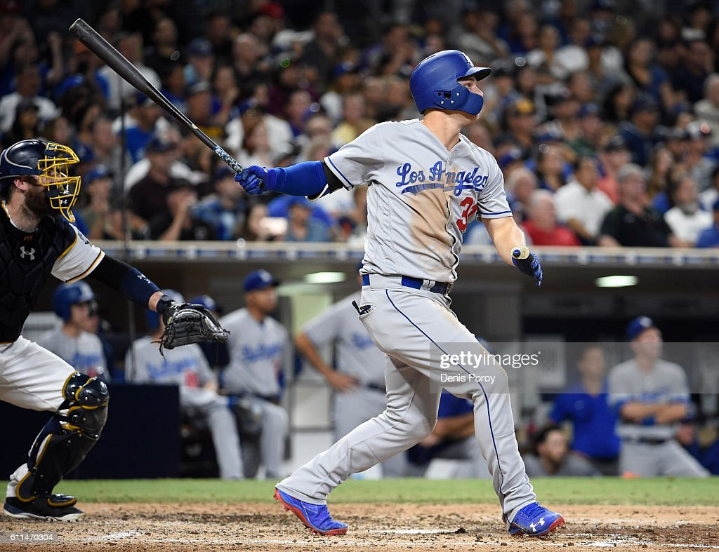 Joc Pederson #31 of the Los Angeles Dodgers hits an RBI double during the sixth inning of a baseball game against the San Diego Padres at PETCO Park on September 29, 2016 in San Diego, California.