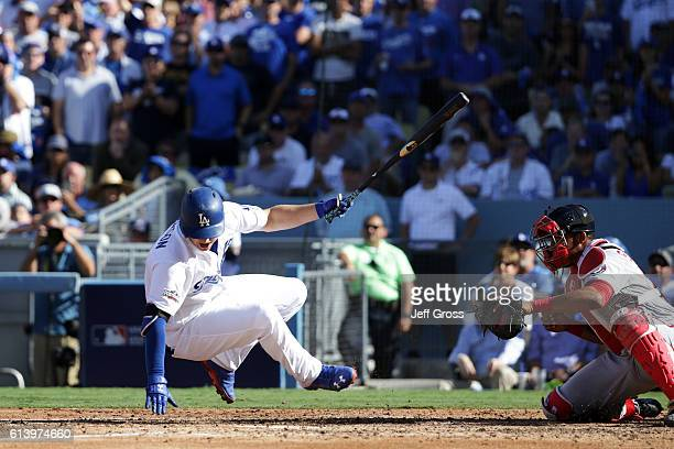 Joc Pederson of the Los Angeles Dodgers is hit by a pitch in the third inning scoring Justin Turner during game four of the National League Division...