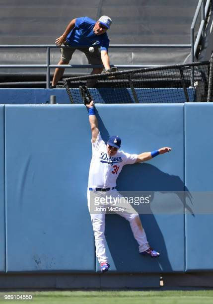 Joc Pederson of the Los Angeles Dodgers jumps for but can not get this home run ball hit by Nolan Arenado of the Colorado Rockies in the fifth...