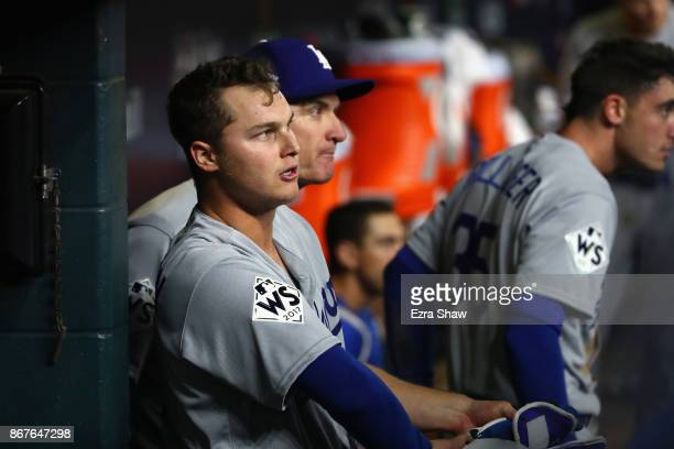 Joc Pederson of the Los Angeles Dodgers looks on from the dugout after a threerun home run during the ninth inning against the Houston Astros in game...