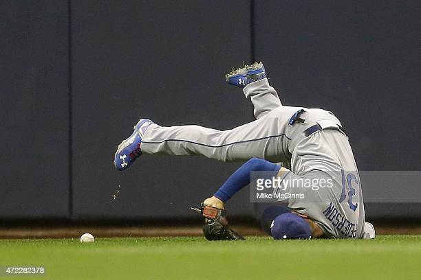 Joc Pederson of the Los Angeles Dodgers misses a catch in center field allowing a RBI double to Jean Segura in the bottom of the second inning during...