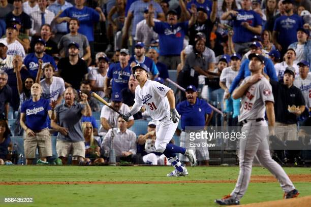 Joc Pederson of the Los Angeles Dodgers reacts after hitting a solo home run during the fifth inning against the Houston Astros in game two of the...
