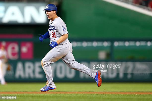 Joc Pederson of the Los Angeles Dodgers rounds the bases after hitting a solo home run to start the seventh inning during Game 5 of NLDS against the...