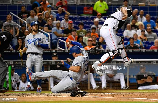 Joc Pederson of the Los Angeles Dodgers scores in the second inning during the game between the Miami Marlins and the Los Angeles Dodgers at Marlins...