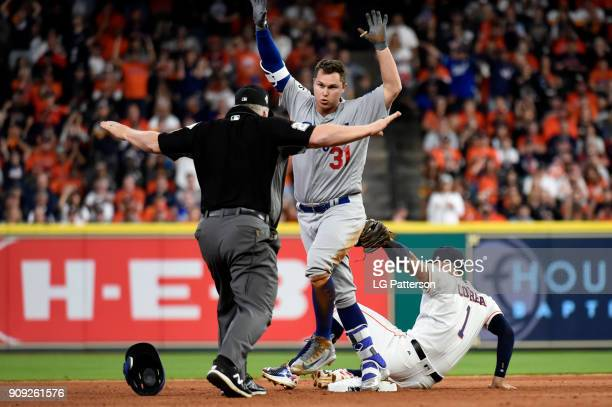 Joc Pederson of the Los Angeles Dodgers slides safely into second with a double as Carlos Correa of the Houston Astros applies the tag in the fifth...