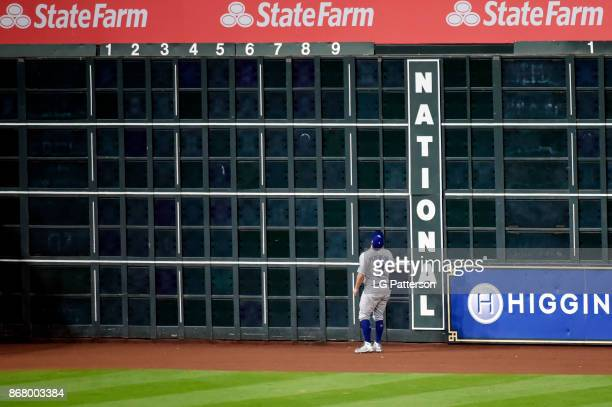 Joc Pederson of the Los Angeles Dodgers watches a Carlos Correa of the Houston Astros tworun home run reach the seats in the seventh inning during...