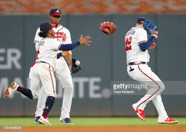 Joc Pederson, Ozzie Albies and Jorge Soler of the Atlanta Braves collide trying to catch a fly ball in the sixth inning of an MLB game against the...