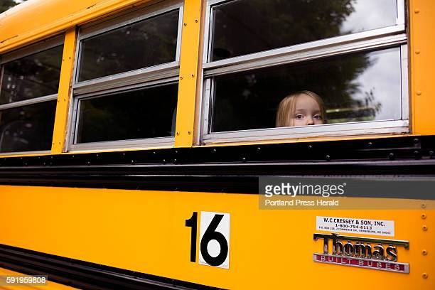 Jocee Baker peers through the school bus window as they pull up to Songo Locks School for her second to last day of their special 'Jump Start'...