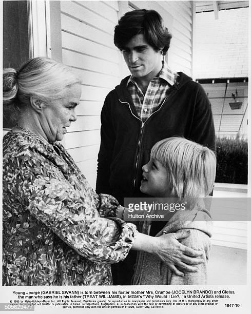Jocelyn Brando talks with young Gabriel Swann as Treat Williams looks on in a scene from the MGM movie Why Would I Lie circa 1980