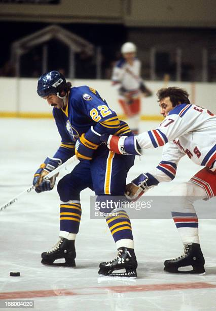 Jocelyn Guevremont of the Buffalo Sabres goes for the puck as Phil Esposito of the New York Rangers defends on December 20 1978 at the Madison Square...