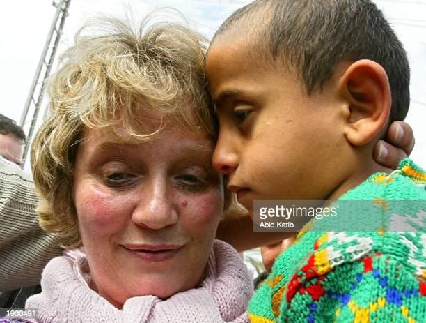 Jocelyn Hurndall , the mother of British peace activist Tom Hurndall, holds six-year-old Slamah Barhom April 14, 2003 in Rafah Refugee Camp which is...