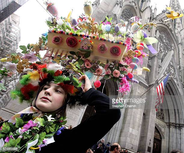 Jocelyn Jeannot balances her Easter bonnet in front of St. Patricks Cathedral on Fifth Avenue on Easter Sunday March 27, 2005 in New York City....