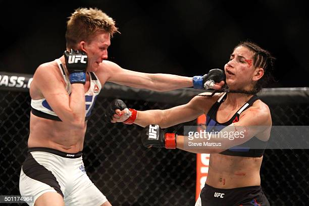 Jocelyn JonesLybarger lands a punch on Tecia Torres in a strawweight fight during UFC 194 at MGM Grand Garden Arena on December 12 2015 in Las Vegas...