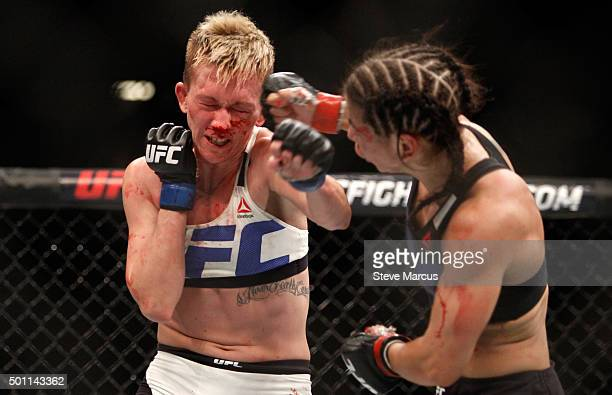 Jocelyn JonesLybarger takes a punch from Tecia Torres in a strawweight fight during UFC 194 on December 12 2015 in Las Vegas Nevada