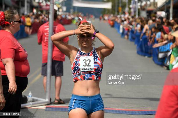 Jocelyn Kopsack reacts after crossing the finish line during the Women's Division of the 91st Running of the Mount Marathon Race on July 4 2018 in...