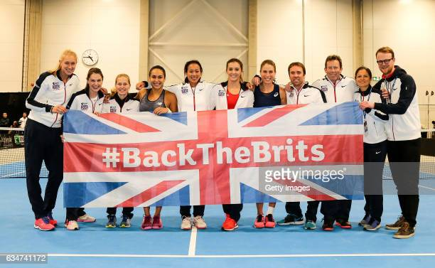 Jocelyn Rae Heather Watson captain Anne Keothavong Laura Robson and Johanna Konta of Great Britain celebrate with fellow team members after the Fed...