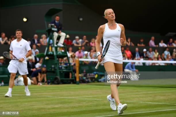 Jocelyn Rae of Great Britain reacts during the Mixed Doubles first round match with Ken Skupski of Great Britain plays a forehand against Edouard...