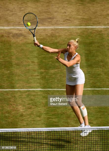 Jocelyn Rae of Great Britain volleys partnering Ken Skupski of Great Britain during the Mixed Doubles quarter final match against Jamie Murray of...