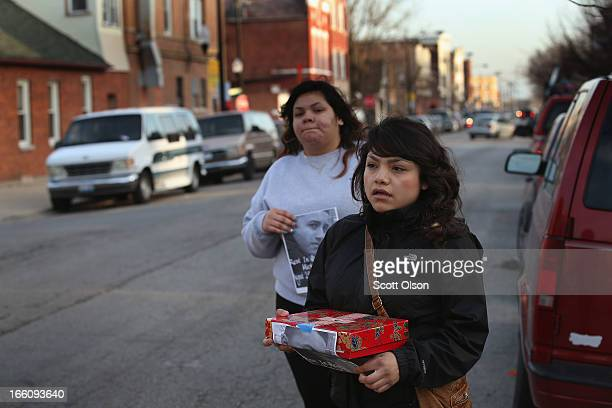 Jocelyn Ramos and Giselle Serrano solicits donations from passersby to help pay for a funeral for their 14yearold friend Michael Orozco on April 8...
