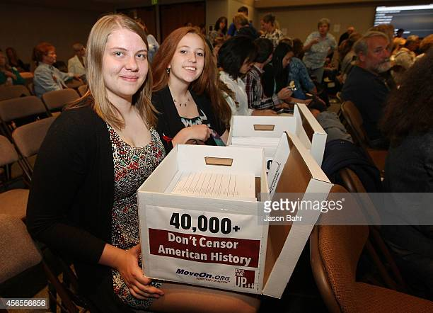 Jocelyn Wallen and Bethany Keupp show off boxes of signed petitions during a recent board meeting at JEFFCO Public Schools on October 2 2014 in...