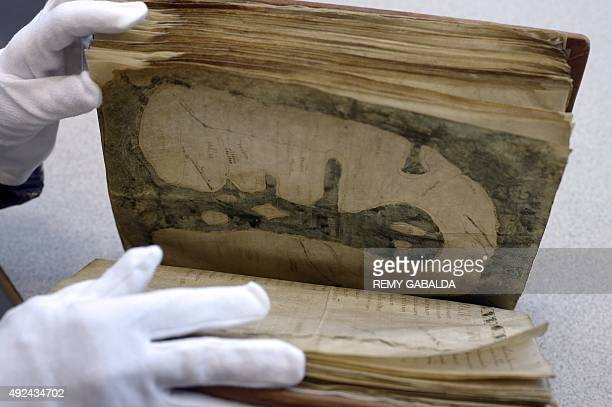 Jocelyne DeschauxBeaume director of the PierreAmalric library presents the Mappa Mundi d'Albi on October 13 2015 in the library in Albi southwestern...