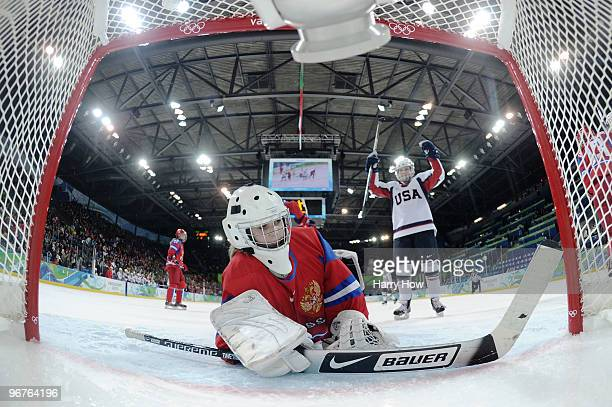 Jocelyne Lamoureux of The United States celebrates scoring their eighth goal as goal keeper Anna Prugova of Russia lies in the goal during the...