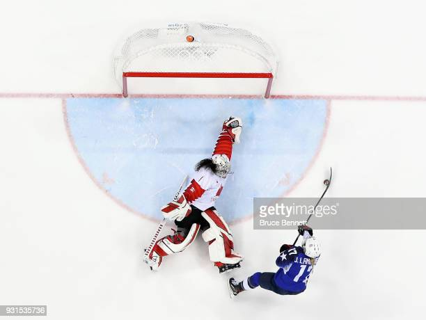 Jocelyne Lamoureux of the United States scores a goal against Shannon Szabados of Canada in a shootout to win the Women's Gold Medal Game on day...