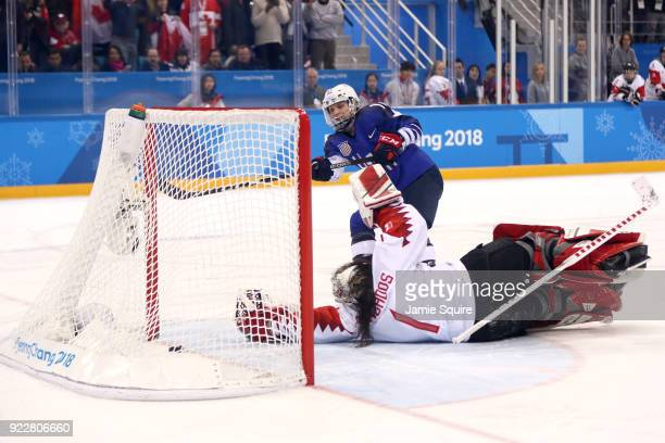 Jocelyne Lamoureux of the United States scores a goal on Shannon Szabados of Canada in overtime during the Women's Gold Medal Game on day thirteen of...