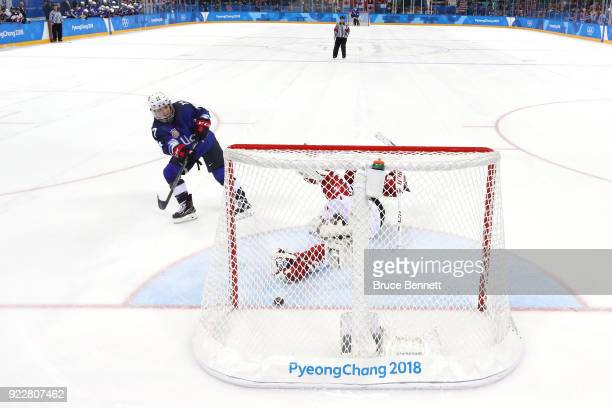Jocelyne Lamoureux of the United States scores the gamewinning goal against Shannon Szabados of Canada in the overtime penaltyshot shootout to win...