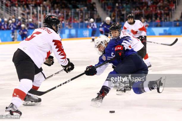 Jocelyne Lamoureux of the United States shoots against Lauriane Rougeau of Canada during the Women's Gold Medal Game on day thirteen of the...