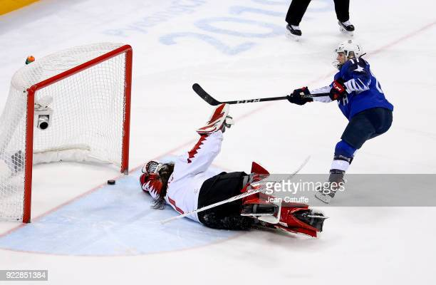 Jocelyne LamoureuxDavidson of USA scores against goalkeeper of Canada Shannon Szabados the game winning goal penalty during the Women's Ice Hockey...
