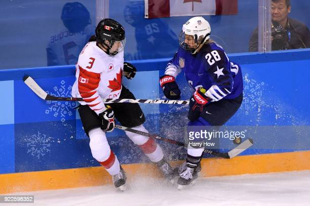 Jocelyne Larocque of Canada and Amanda Kessel of the United States battle for the puck in the first period during the Women's Gold Medal Game on day...