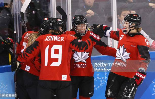Jocelyne Larocque of Canada and Jennifer Wakefield of Canada celebrate after a goal by Meghan Agosta of Canada in the second period against the...
