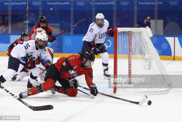 Jocelyne Larocque of Canada reaches for the puck in the first period against the United States during the Women's Ice Hockey Preliminary Round Group...