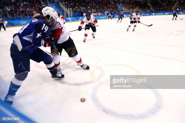 Jocelyne Larocque of Canada skates against Brianna Decker of the United States in the third period during the Women's Gold Medal Game on day thirteen...