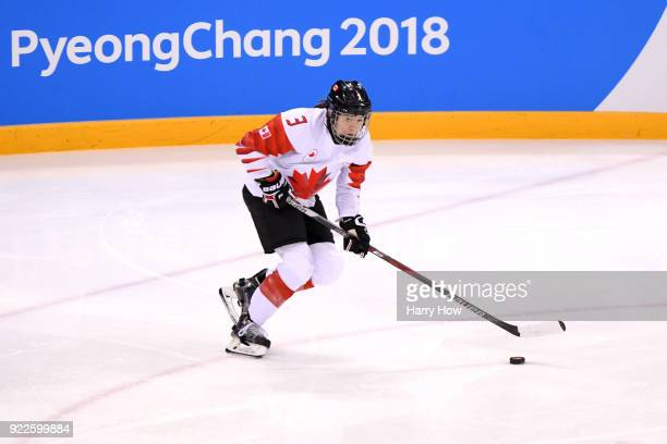 Jocelyne Larocque of Canada skates with the puck against the United States in the first period during the Women's Gold Medal Game on day thirteen of...