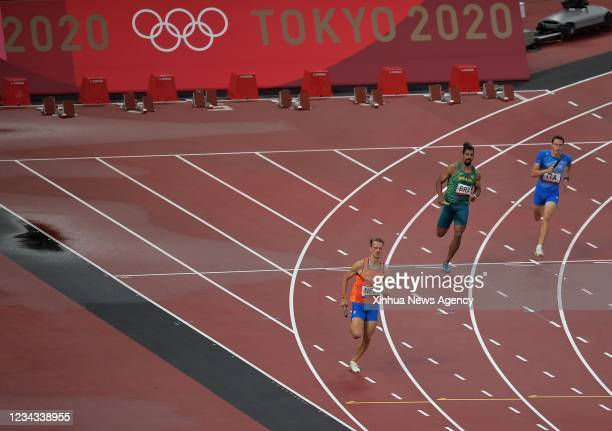 Jochem Dobber L of the Netherlands competes during the 4x400m Relay Mixed Heat at the Tokyo 2020 Olympic Games in Tokyo, Japan ,July 30, 2021.