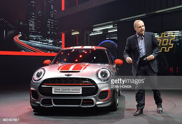 Jochen Goller vicepresident of MINI sales presents a Mini Cooper during a press preview at the North American International Auto Show January 13 2014...