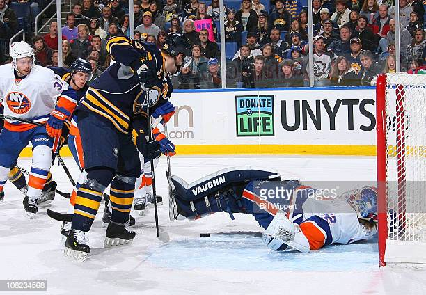 Jochen Hecht of the Buffalo Sabres can't get the puck past sprawling goaltender Nathan Lawson of the New York Islanders at HSBC Arena on January 21,...