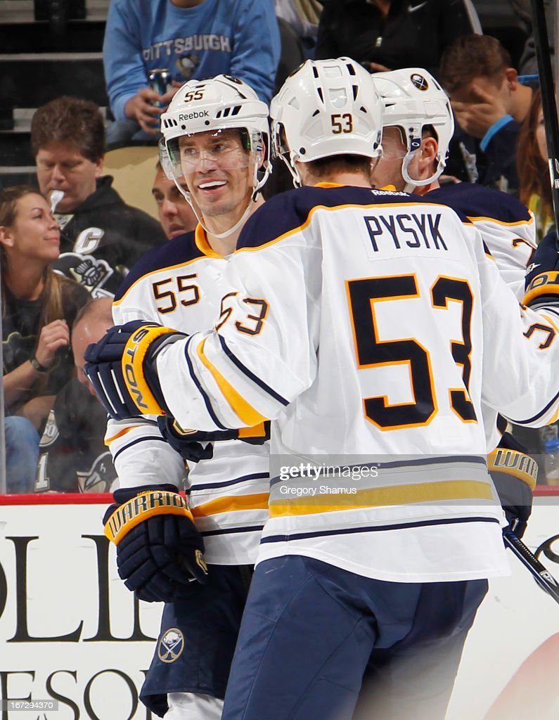 Jochen Hecht #55 of the Buffalo Sabres celebrates his goal with Mark Pysyk #53 during the third period against the Pittsburgh Penguins on April 23, 2013 at Consol Energy Center in Pittsburgh, Pennsylvania. Buffalo won the game 4-2.